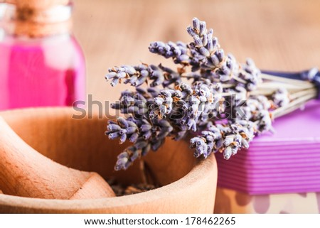 Dry lavender bunch and wooden mortar, preparation - stock photo