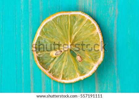 Dry lemon fruit on the blue wooden background
