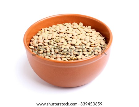 Dry lentils in a bowl isolated on a white background. - stock photo