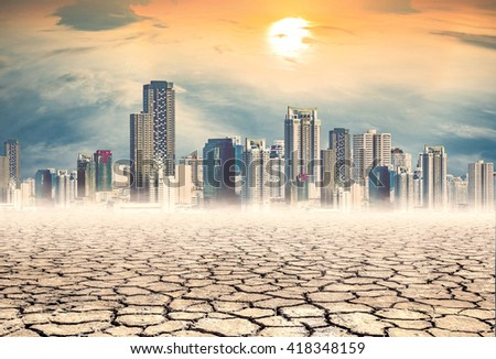 "dry mud which lack of water on city background,expression on ""EL nino"" climate effect - stock photo"