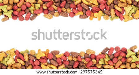 Dry multicolored pet food (dog or cat) on white background - stock photo