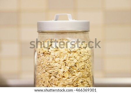 Dry oat flakes in a glass container