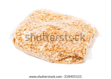 dry peas in the package on a white background - stock photo