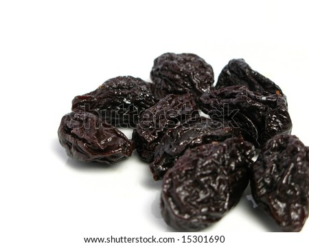 Dry plum or prune fruit isolated on white background - stock photo