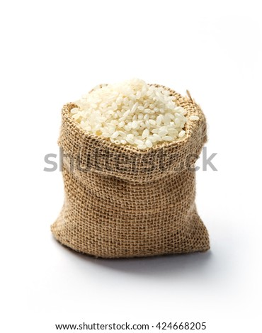 Dry rice grains in burlap