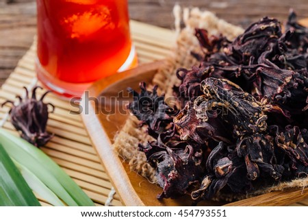 dry roselle with ice roselle juice on wooden table ,healthy food