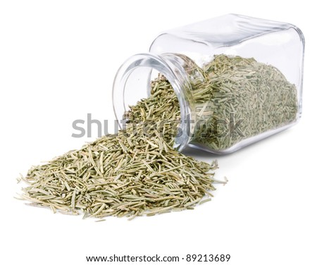 Dry rosemary is scattered on a white background from glass bottle - stock photo