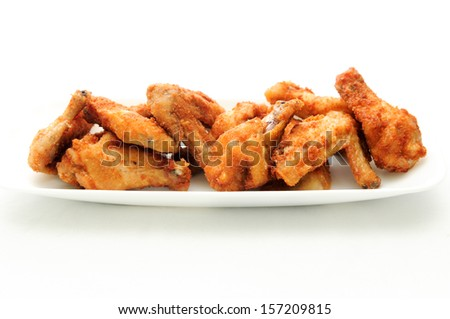 dry rub deep fried chicken wings, heartburn on a plate - stock photo