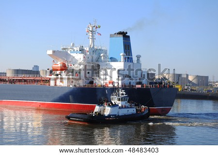 dry ship entering the port - stock photo
