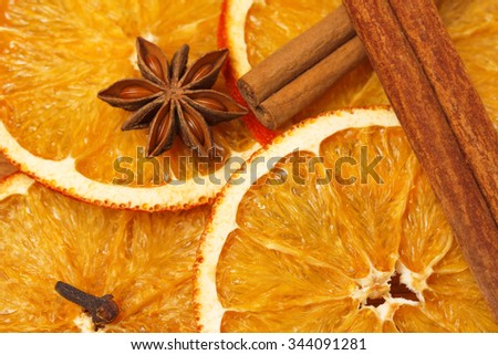 Dry slices of orange, cinnamon, cloves and anise - stock photo