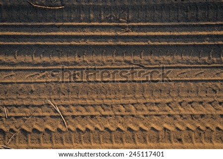 Dry soil background in warm colors closeup - stock photo