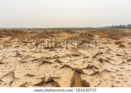Dry soil crack texture with direct hot sunlight - stock photo