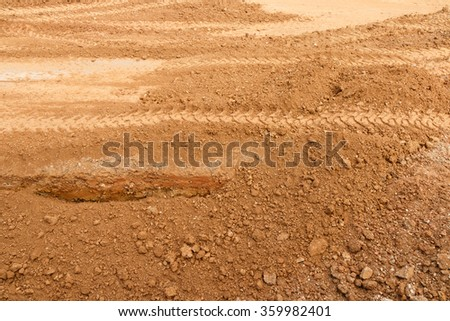 Dry soil field under construction texture.