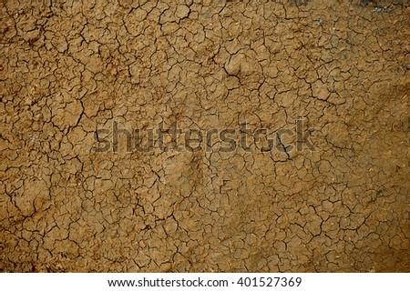 Dry soil texture background. - stock photo