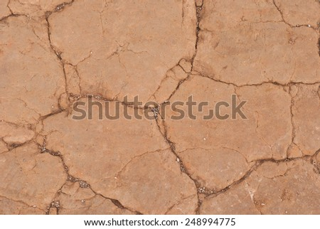 Dry soil texture background into the dry season - stock photo