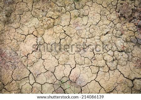 Dry soil texture of a barren land - stock photo