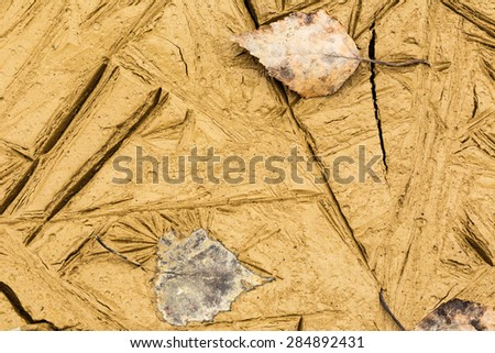 Dry soil textured as background in closeup - stock photo