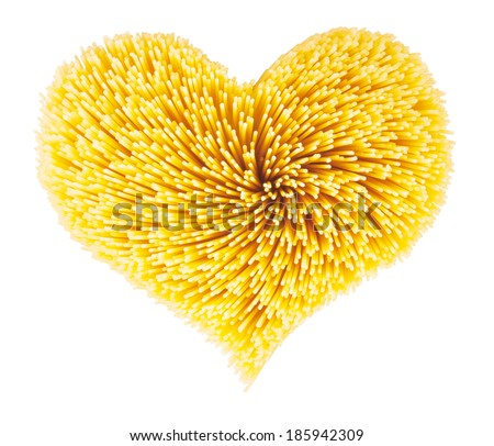 Dry spaghetti in the shape of heart - stock photo