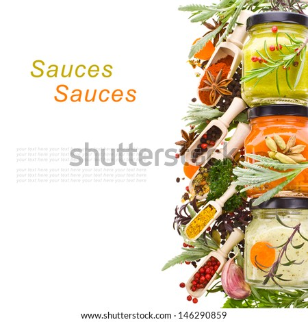 dry spices, fresh herbs and cooking sauces in jars board isolated on white background - stock photo