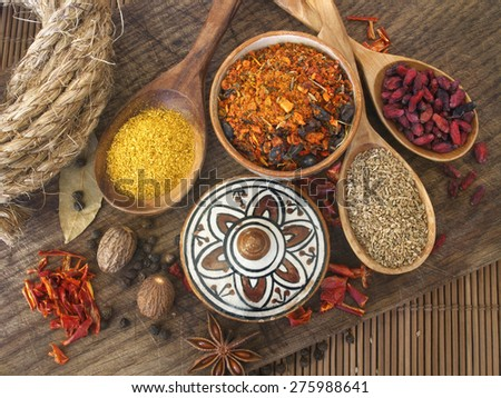 dry spices on the wooden board and wooden spoons