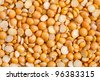Dry split yellow peas texture background. Great for soups, puree. - stock photo