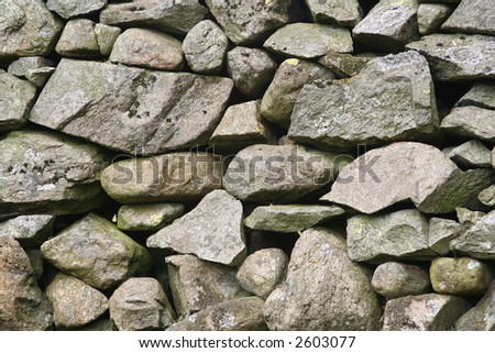 Dry stone wall background or texture - stock photo