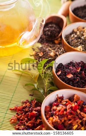 Dry tea in bowls, low depth of focus - stock photo