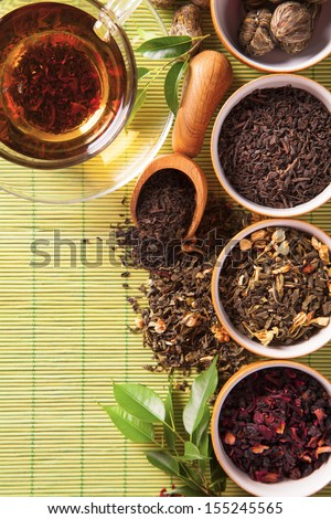 Dry tea in bowls shot from upper view - stock photo