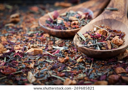 Dry tea on wooden table - stock photo