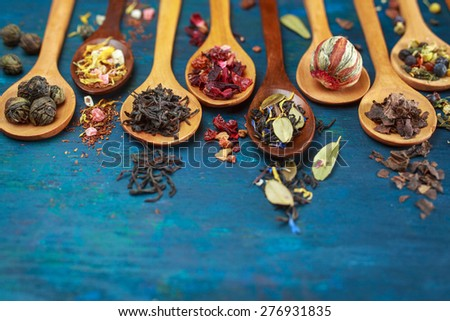 Dry tea with in wooden spoons. Selective focus - stock photo