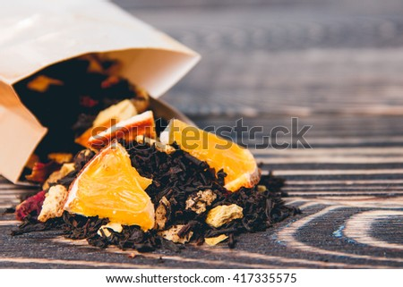 Dry Tea Wooden Background. Healthcare, Food and Drink Concept