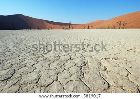 Dry terrain and dune - Lack of water. Namibia, Deadvlei, Sossuvlei. - stock photo