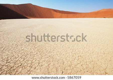 Dry terrain and dune - Lack of water. Namibia, Deadvlei, Sossuvlei. - stock photo
