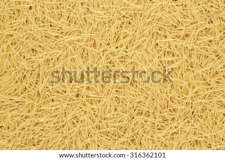 dry uncooked pasta on the table texture background - stock photo