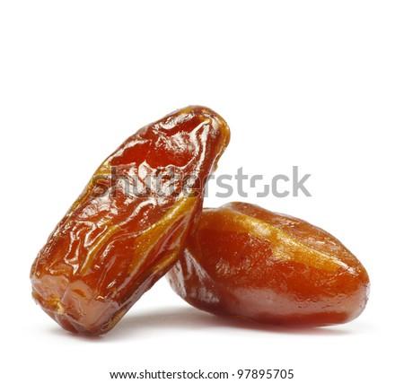 dryed dates on white background - stock photo