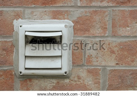 Dryer vent on a brick wall