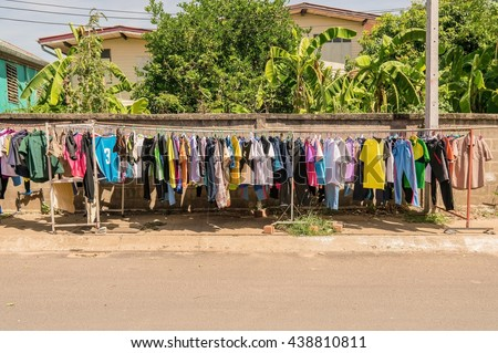 Drying cloth.hanging cloth outdoor.laundry - Drying cloth and swaddle on hanger.  unbleached cloth, dry clothes in air and sun - stock photo