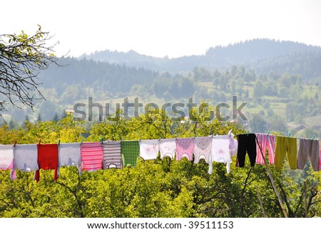 Drying clothes for baby on wire - stock photo