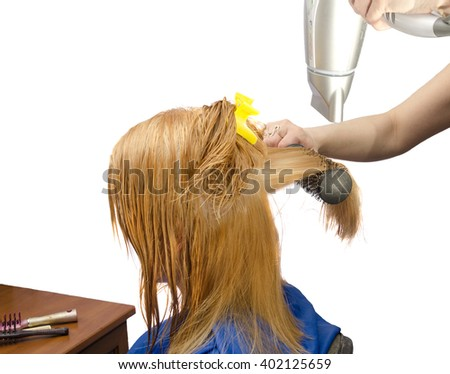 drying ginger  painted  hair with the hairdryer, white background - stock photo