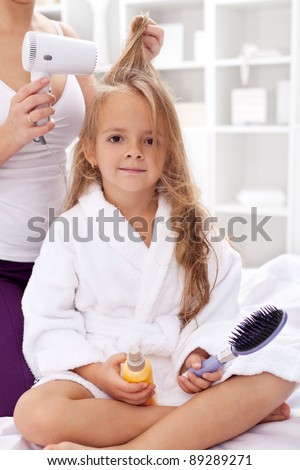 Drying hair after bath - little girl personal hygiene activities - stock photo