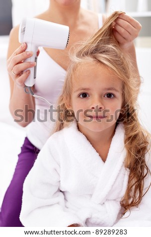 Drying hair - little girls after bath activities - stock photo