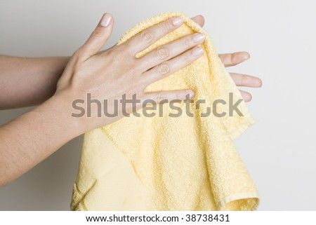 Drying hands with a towel - stock photo