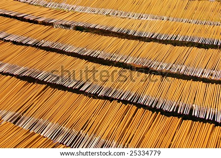 Drying incense sticks at a small factory in the mountains near Sapa in Vietnam