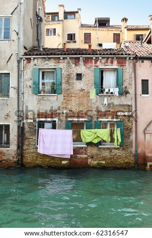 Drying laundry in colorful Venice, Italy - stock photo