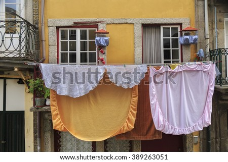 Drying linen hanging outside of house, Porto, Portugal