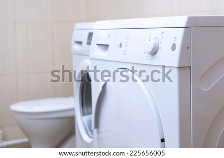 drying machine, laundry washer  and lavatory bowl in the bathroom, white and clean - stock photo