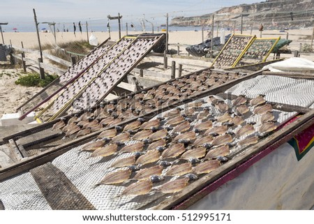 Drying mackerel fish for sale on the beach of Nazare, Portugal