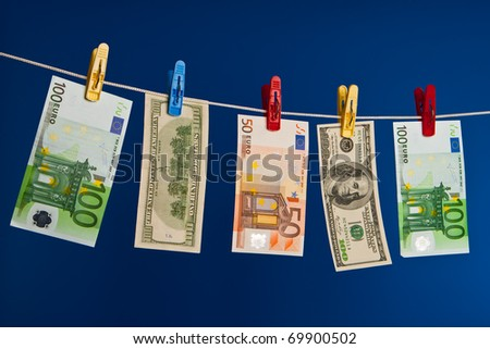 Drying of money after washing up - stock photo