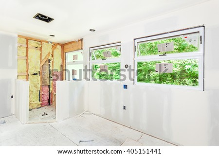 Drywall seams have been taped and smoothed with mud (spackle) - stock photo