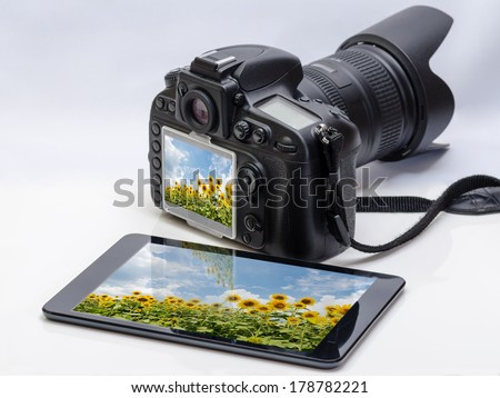 DSLR and tablet - stock photo